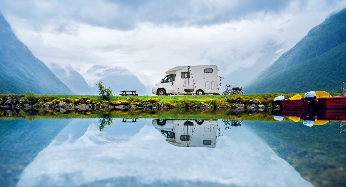 Caravan with water and mountains around it