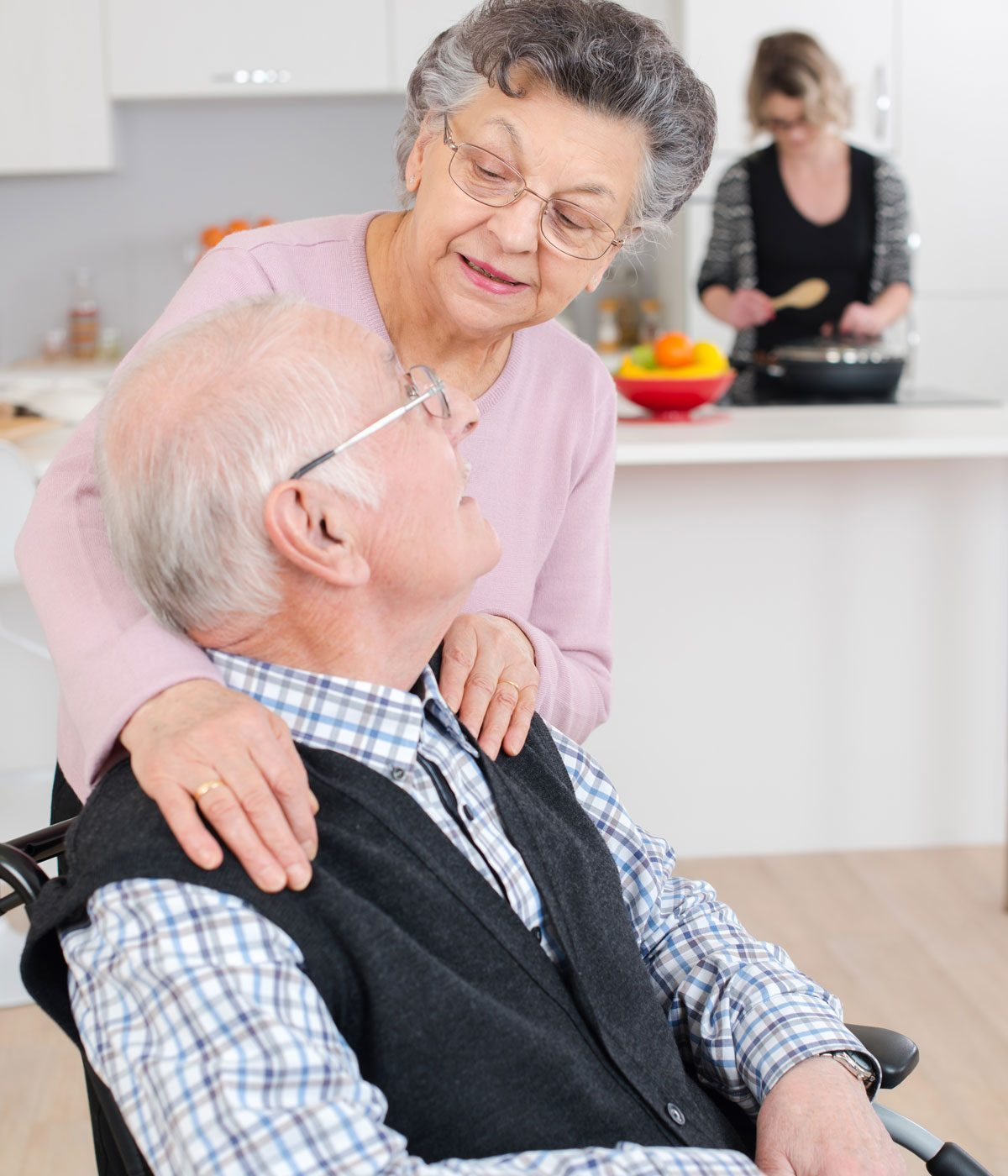 Two elderly people looking at each other