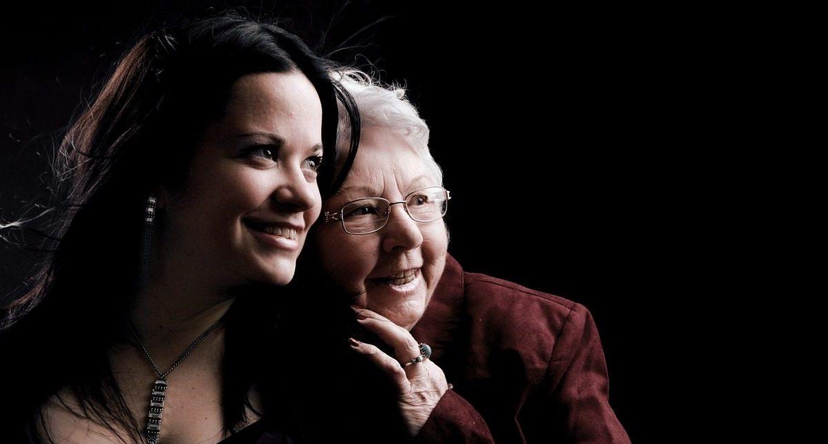 Elderly woman with her grandchild