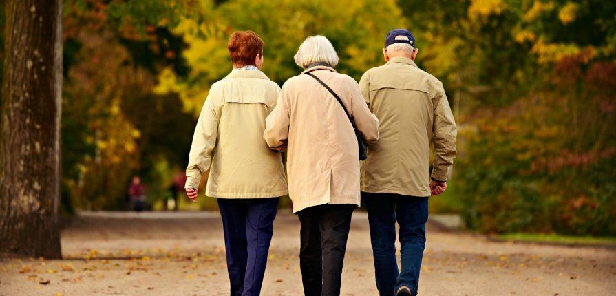 elderly people walking together