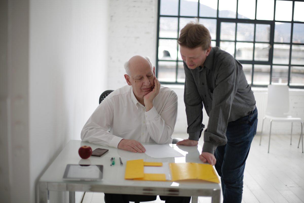 men in office doing financial preparation for retirement