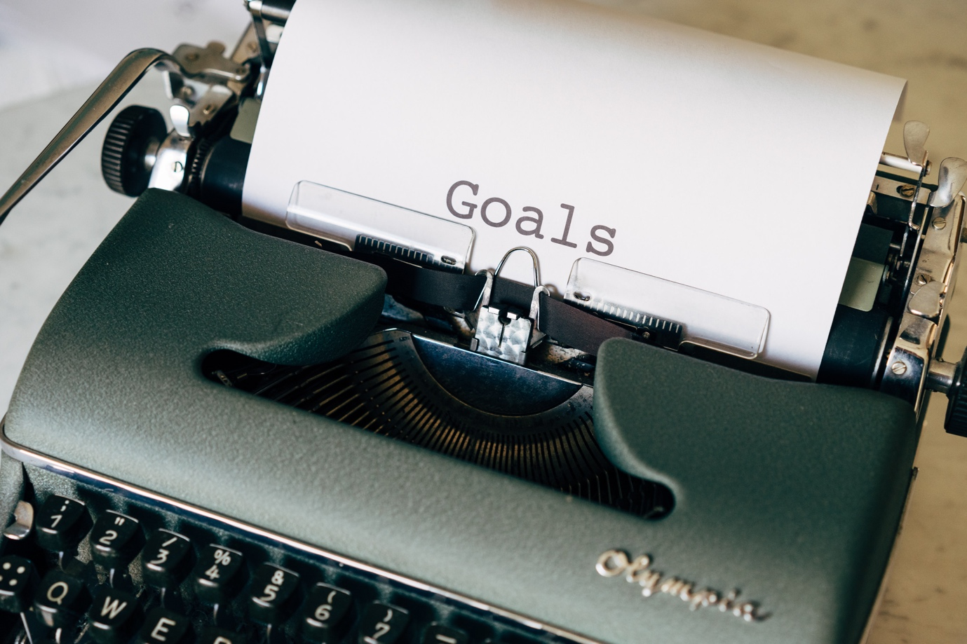 typewriter with paper that says GOALS