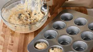muffin mixture in muffin tray